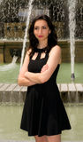 Beautiful girl posing in front of a fountain Royalty Free Stock Photography