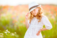 Beautiful girl posing in a hat outdoor. The beautiful girl posing in a hat outdoor stock images