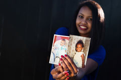 Beautiful girl posing holding her baby pictures Stock Photography