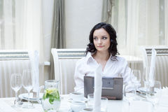 Beautiful girl posing with laptop in restaurant Stock Photo