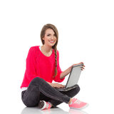 Beautiful girl is posing with a laptop Stock Photo