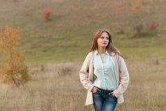 Beautiful girl posing in a meadow. Royalty Free Stock Photo