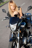 Beautiful girl posing on motorcycle Royalty Free Stock Photo