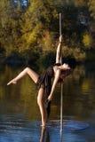 Beautiful girl posing near a pole dance. Stock Images