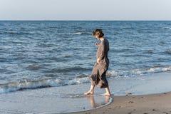 Beautiful girl posing near the sea. Beautiful girl posing in a dress near the sea Royalty Free Stock Image