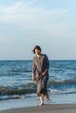Beautiful girl posing near the sea. Beautiful girl posing in a dress near the sea Royalty Free Stock Photo