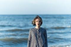 Beautiful girl posing near the sea. Beautiful girl posing in a dress near the sea Stock Photos