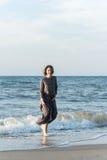 Beautiful girl posing near the sea. Beautiful girl posing in a dress near the sea Stock Photography