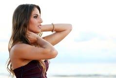 Beautiful girl posing near the sea Stock Photo