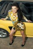 Beautiful girl posing near sport car Stock Image