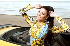 Beautiful girl posing near sport car Stock Photos