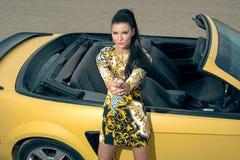 Beautiful girl posing near sport car stock images