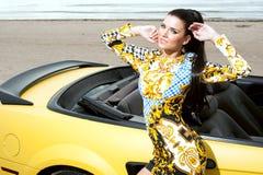Beautiful girl posing near sport car Royalty Free Stock Photography