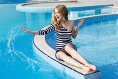 Beautiful girl posing near the swimming pool Royalty Free Stock Image