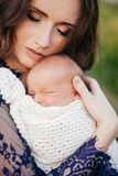 Beautiful girl with newborn son in her arms royalty free stock photography