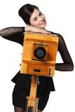 Beautiful girl posing with old camera Stock Images