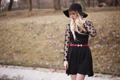Beautiful girl in posing outdoors Stock Photo