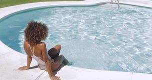 Beautiful girl posing in poolside stock footage