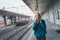 Beautiful girl posing in a railroad station Stock Photo