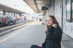 Beautiful girl posing in a railroad station Royalty Free Stock Photography