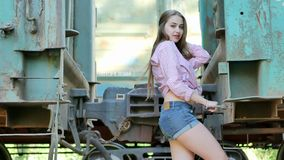 Beautiful girl posing between railway stock video