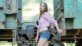 Beautiful girl posing between railway stock footage