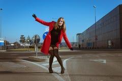 Beautiful girl posing with red coat. Beautiful girl posing in the street with red coat Royalty Free Stock Photo