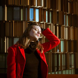 Beautiful girl posing with red coat. Beautiful girl posing in the street with red coat Royalty Free Stock Images