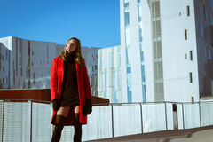 Beautiful girl posing with red coat Stock Photography