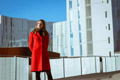 Beautiful girl posing with red coat Stock Photos