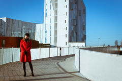 Beautiful girl posing with red coat Royalty Free Stock Image