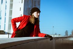 Beautiful girl posing with red coat Royalty Free Stock Photos