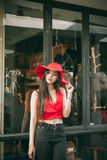 Beautiful girl is posing with red suit. And red hat Stock Image