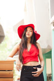 Beautiful girl is posing with red suit. And red hat Stock Photography