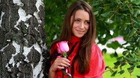 Beautiful girl posing with rose. stock video footage