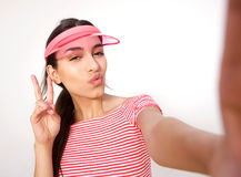 Beautiful girl posing for selfie with peace hand sign Stock Photos