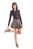 Beautiful girl posing in short skirt. Royalty Free Stock Photography