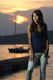 Beautiful girl posing in strong sunset light Stock Photos