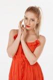 Beautiful girl posing in studio. In red dress Royalty Free Stock Images