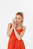 Beautiful girl posing in studio. In red dress Stock Images