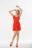 Beautiful girl posing in studio. In red dress Royalty Free Stock Photography