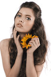 Beautiful girl posing with a sunflower Royalty Free Stock Images