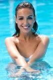 Beautiful girl posing in the swimming pool. Royalty Free Stock Photos