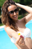 Beautiful girl posing at the swimming pool. Royalty Free Stock Photo