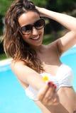 Beautiful girl posing at the swimming pool. Royalty Free Stock Photo
