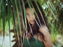 Beautiful girl posing in tropical forest. Close-up perfect portrait Stock Image