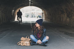 Beautiful girl posing in a tunnel Stock Images