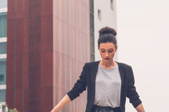 Beautiful girl posing in an urban context Stock Image