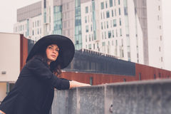 Beautiful girl posing in an urban context Stock Photography