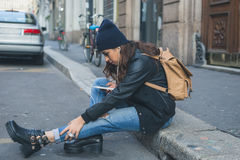 Beautiful girl posing in an urban context Stock Photography